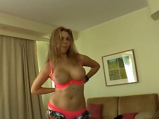 A Blonde Shows Us And She Also Shakers Her Large Tits