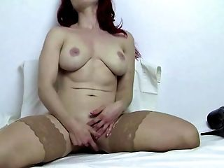 Sexy Ginger-haired Andrea Masturbates In Stockings