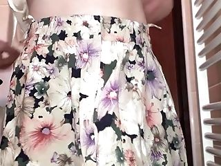 Obedient And Her Flowery Miniskirt With Shiny Lining.