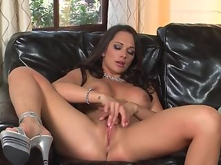 A Fine And Fit Lady Is Massaging Her Fuckbox On The Leather Sofa
