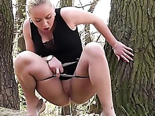 Hot Nymph Lifts Her Black Sundress And Pisses Outdoors