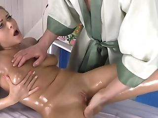 Oiled Woman With Beautiful Face Deals With Massagist's Hard Pink Cigar